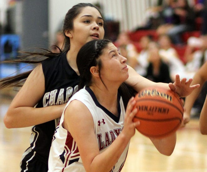 Senior Lady 'Cat Adriana Giron was big on the glass during Tuesday's 63-21 home- and season-opening win over the Chaparral High Lobos at Frank Dooley Court on the campus of Deming High School. Giron also pumped in nine points.