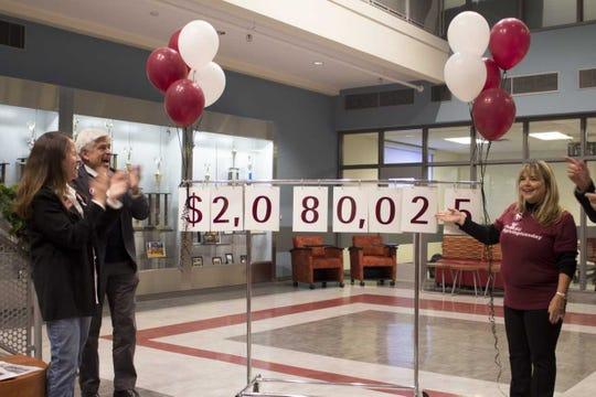 New Mexico State University officials react after reaching the $2 million in donations on Giving Tuesday. From left, NMSU Regent Jerean Hutchinson, NMSU Chancellor Dan Arvizu and NMSU Foundation Interim President Tina Byford.