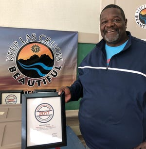 Keep Las Cruces Beautiful Coordinator James Woods holds the Keep America Beautiful President's Circle Recognition Award for 2017. It is the third consecutive year the City has earned this recognition.