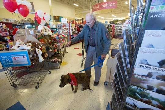 "Henry Evarts, and  his dog Sugar Plum in the Petco on Lohman, Wednesday November 28, 2018.  PetCo is giving $10,000 to Animal Village of New Mexico, the orginization that Evarts adopted Sugar Plum from. Evarts said when asked about ""Sugar"" ""Well I'm 90 years old and when I'm with Sugar she makes me feel at least 89, she is a good dog...she is good company."""