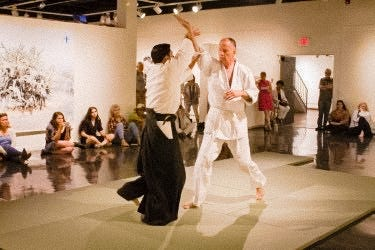 "Local aikido practitioners perform at the New Mexico State University Art Gallery as part of the ongoing programming for the current exhibition ""Superbloom."""