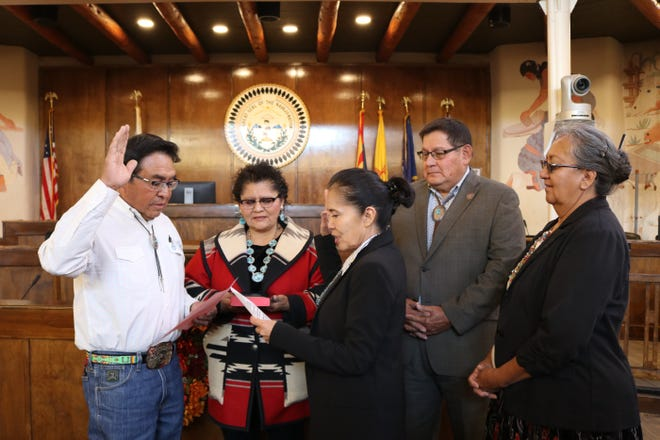 Jimmy Yellowhair, left, was sworn into office Wednesday at the Navajo Nation Council Chamber in Window Rock, Ariz. Chief Justice JoAnn B. Jayne, third from left, administered the oath.