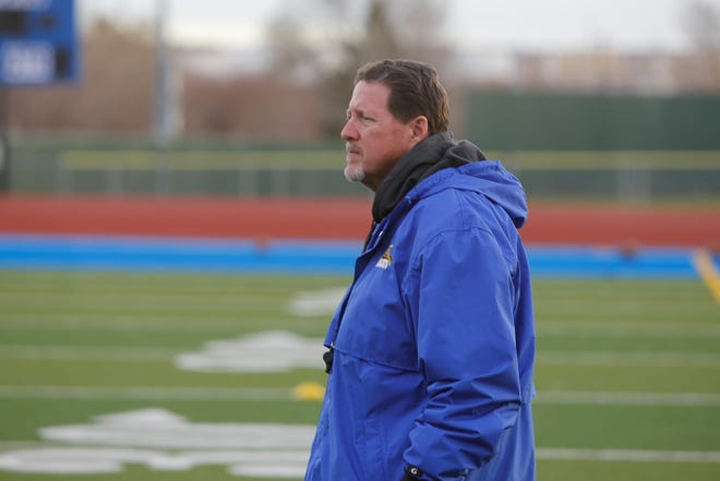 Bloomfield coach Bob Allcorn watches his team practice Tuesday at Bobcat Stadium. Allcorn, a 1982 BHS graduate, looks to bring home a state title to his alma mater.