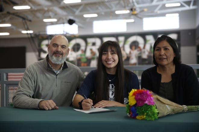 Farmington's JJ Curry signs her letter of intent on Wednesday to continue her volleyball career at Frank Phillips College, located in Borger, Texas.
