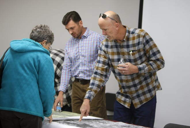 Wilson & Company Project Design Engineer Conrad Ley and Mountain States Construction Project Manager Mike Brown answer questions about future construction on U.S. Highway 64, Wednesday at McGee Park in Farmington.