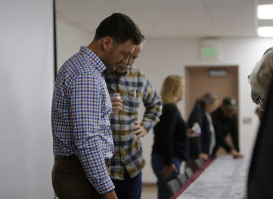 Wilson & Company Project Design Engineer Conrad Ley and Mountain States Construction Project Manager Mike Brown answer questions about future construction on U.S. Highway 64, Wednesday, Nov. 28, 2018, at McGee Park in Farmington.