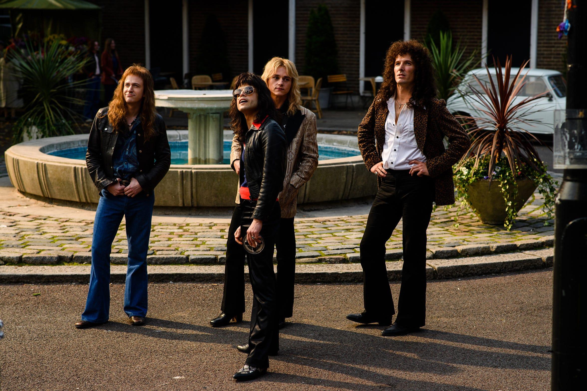 "From left to right: Joe Mazzello (John Deacon), Rami Malek (Freddie Mercury), Ben Hardy (Roger Taylor), and Gwilym Lee (Brian May) star in Twentieth Century Fox's ""Bohemian Rhapsody."""