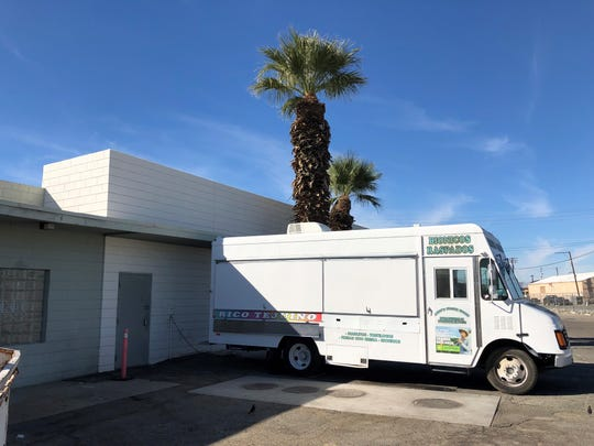 A mobile food truck is parked outside of Sacher Enterprises, the Coachella Valley's first and only food truck commissary.