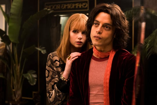 "From left to right: Lucy Boynton (Mary Austin) and Rami Malek (Freddie Mercury) star in Twentieth Century Fox's ""Bohemian Rhapsody."""