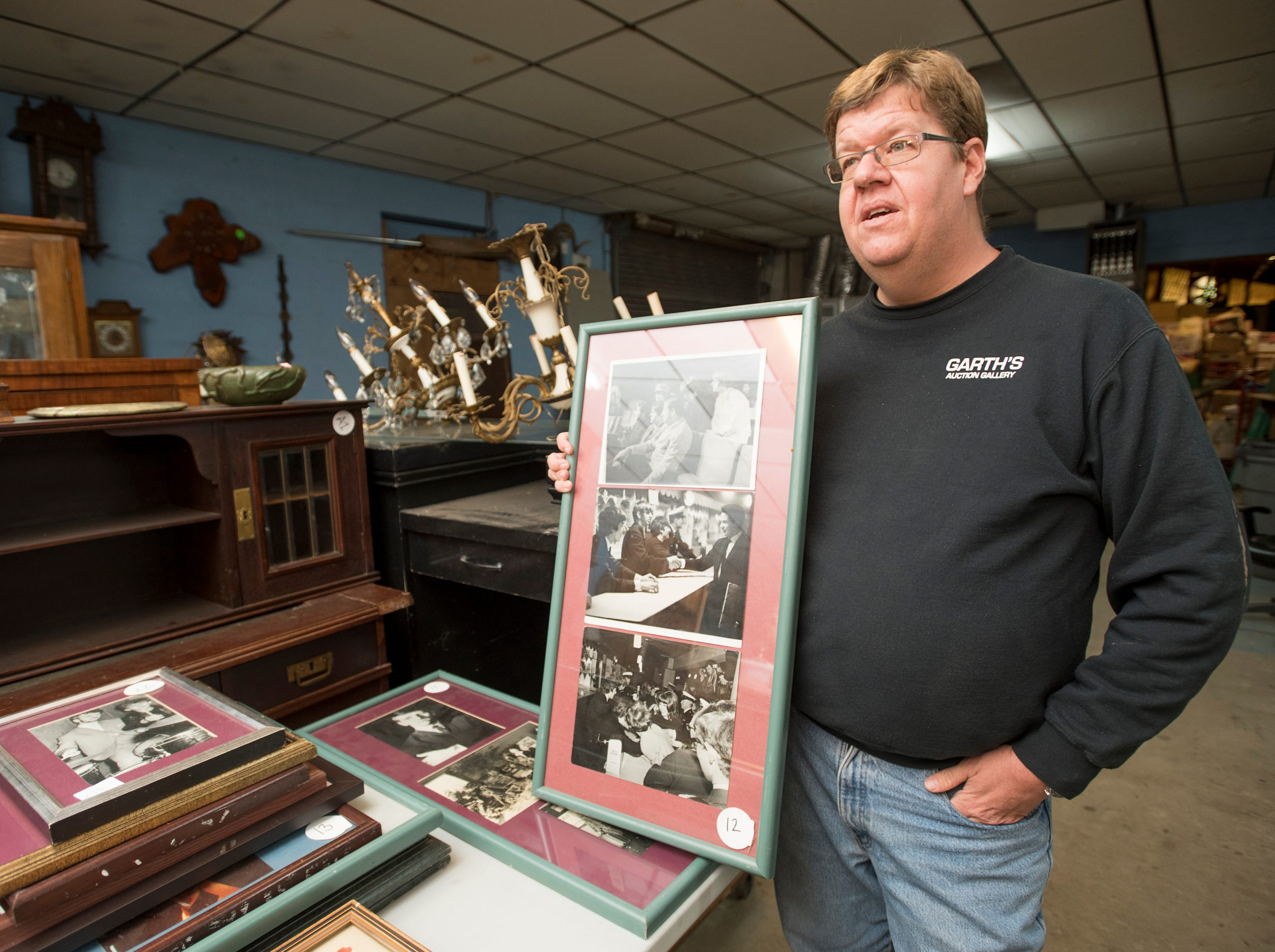 Owner Robert Garth talks about original Beatles photographic prints at Garth's Auction & Antiques on Navy Boulevard in Pensacola on Wednesday, November 28, 2018.  These and other items will be up for sale during their auction on Friday, November 30th.