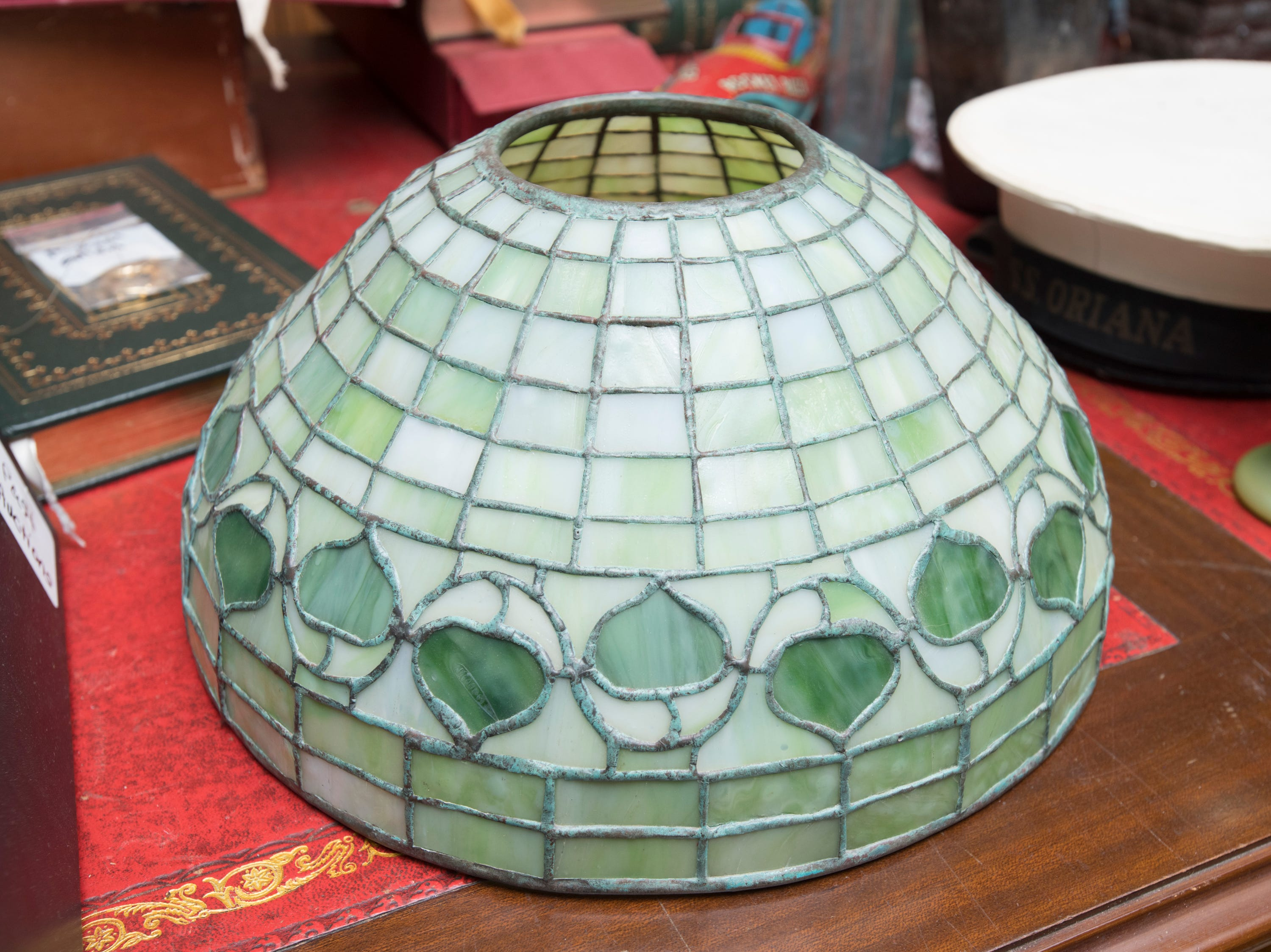 The Tiffany glass shade of a lamp at Garth's Auction & Antiques on Navy Boulevard in Pensacola on Wednesday, November 28, 2018.  This and other items will be up for sale during their auction on Friday, November 30th.