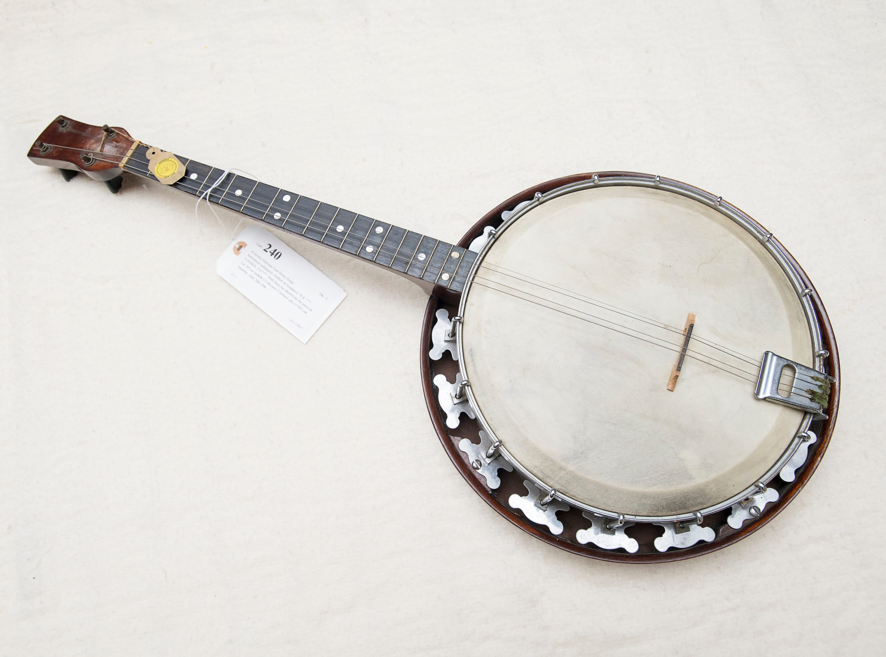 A George Harrison banjo at Garth's Auction & Antiques on Navy Boulevard in Pensacola on Wednesday, November 28, 2018.  The banjo and other items will be up for sale during their auction on Friday, November 30th.