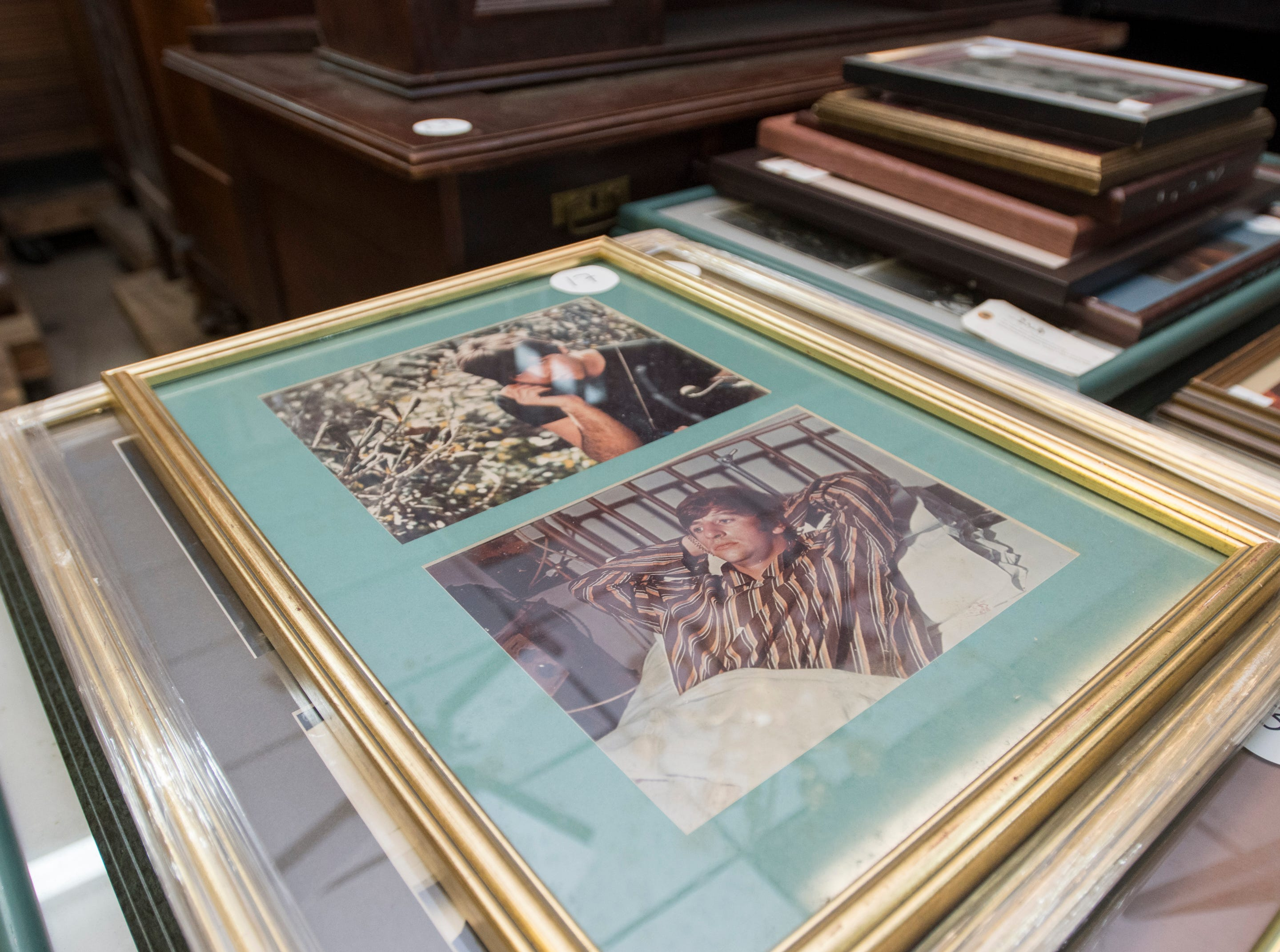 Original Beatles photographic prints at Garth's Auction & Antiques on Navy Boulevard in Pensacola on Wednesday, November 28, 2018.  These and other items will be up for sale during their auction on Friday, November 30th.