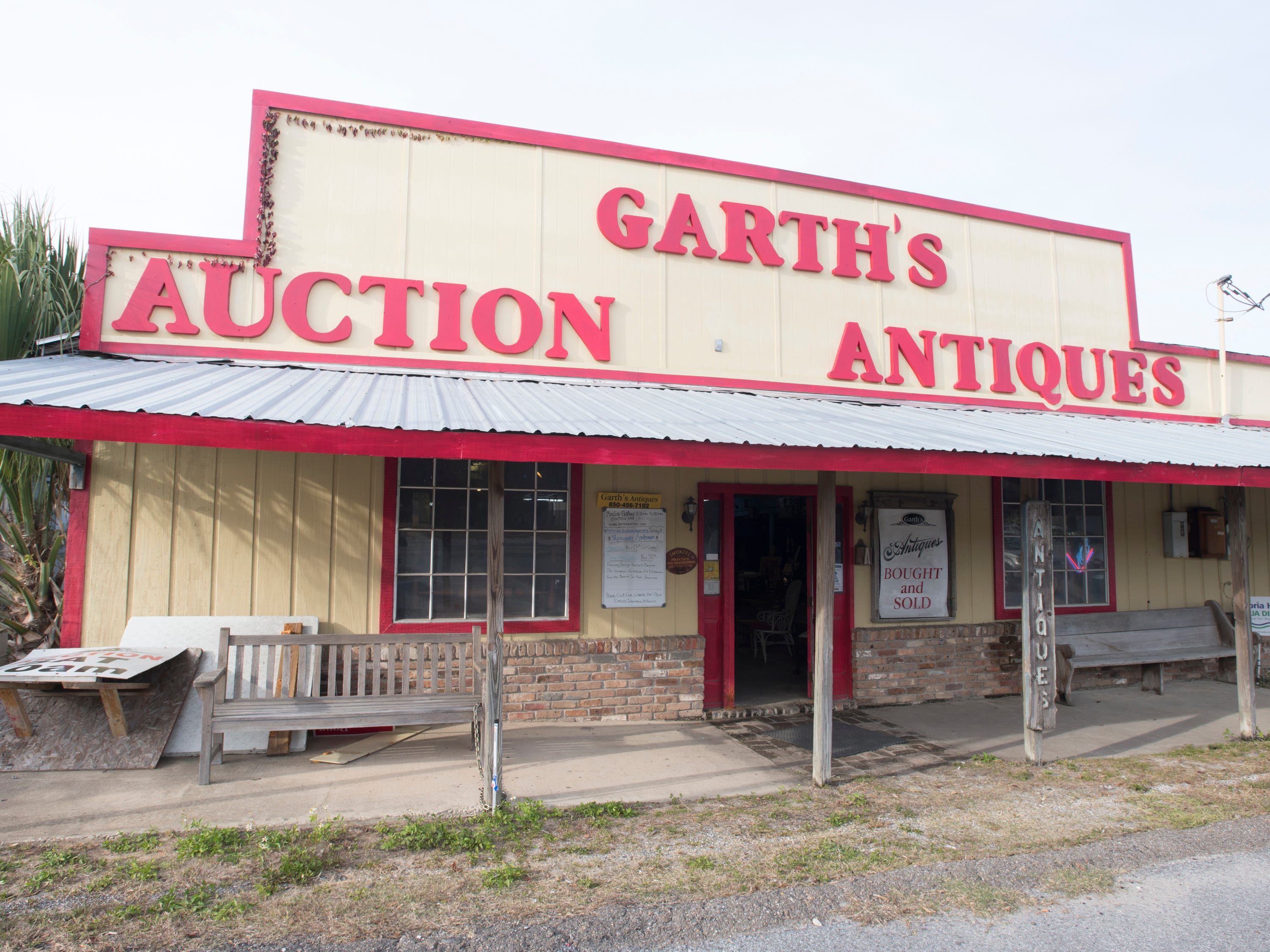 Exterior of Garth's Auction & Antiques on Navy Boulevard in Pensacola on Wednesday, November 28, 2018.  A George Harrison banjo, Pre-Columbian art and other items will be up for sale during their auction on Friday, November 30th.