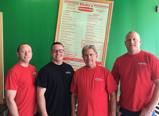From left, Ross Calloway Jr., Benjamin Calloway, Ross Calloway Sr. and Jacob Calloway. Ross Sr.'s three sons will each have their own Philly's store by the end of the year, when Jacob takes over the franchise's third location.