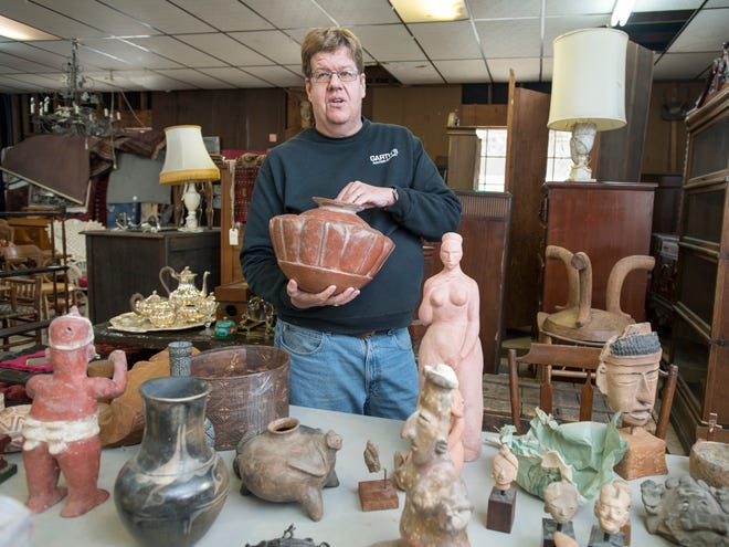 Owner Robert Garth talks about Pre-Columbian art at Garth's Auction & Antiques on Navy Boulevard in Pensacola on Wednesday, November 28, 2018.  These and other items will be up for sale during their auction on Friday, November 30th.