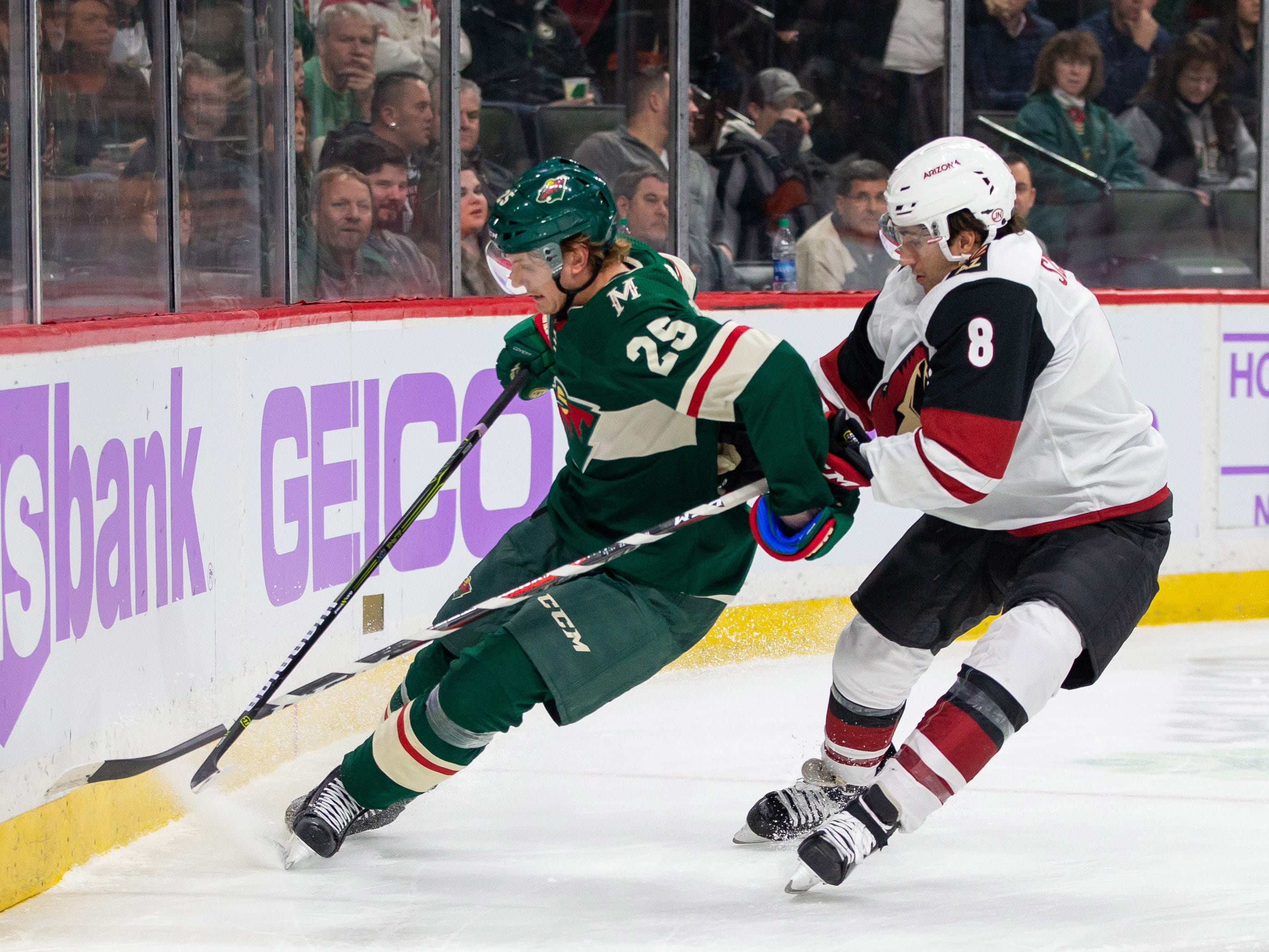 Nov 27, 2018; Saint Paul, MN, USA; Minnesota Wild defenseman Jonas Brodin (25) defends Phoenix Coyotes forward Nick Schmaltz (8) in the first period at Xcel Energy Center. Mandatory Credit: Brad Rempel-USA TODAY Sports