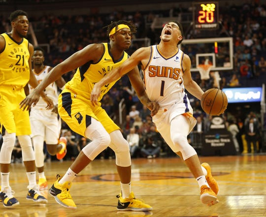 Phoenix Suns guard Devin Booker (1) is fouled by Indiana Pacers center Myles Turner (33) during the first quarter November 27.