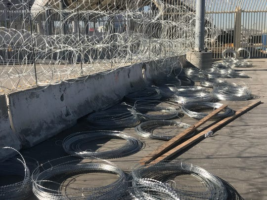 Coils of concertina wire sit at the San Ysidro crossing in San Diego. Officers used them to keep migrants from rushing the port, forcing them to shut down the world's busiest land border crossing for a few hours on Sunday.