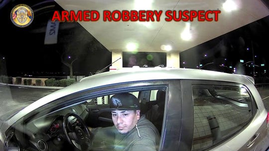 Peoria police released this surveillance camera photo Tuesday of a suspect in the Nov. 20 robbery at a drive-thru ATM.