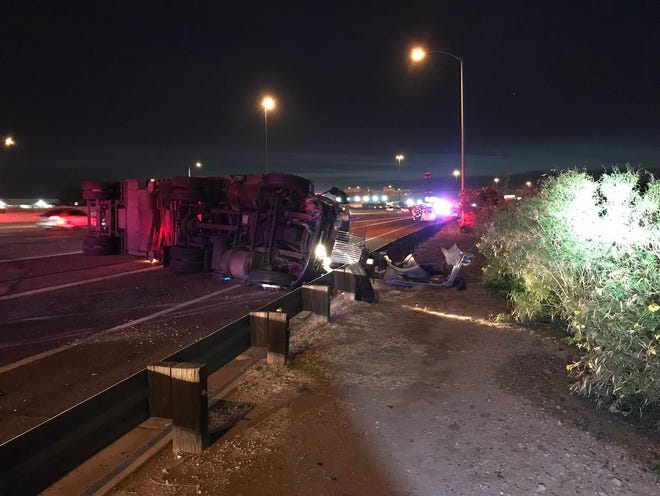 A crash involving an overturned semi truck is causing delays on eastbound Interstate 10 near 24th Street in Phoenix, Nov. 28, 2018.