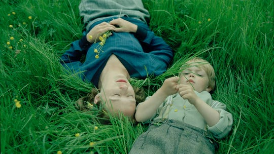 "Alba August and Marius Damslev in ""Becoming Astrid."""