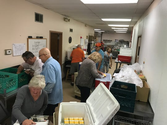 Drivers start their day at the YWCA Valley West Senior Center in Glendale to gather the items they'll need for their Meals on Wheels routes.