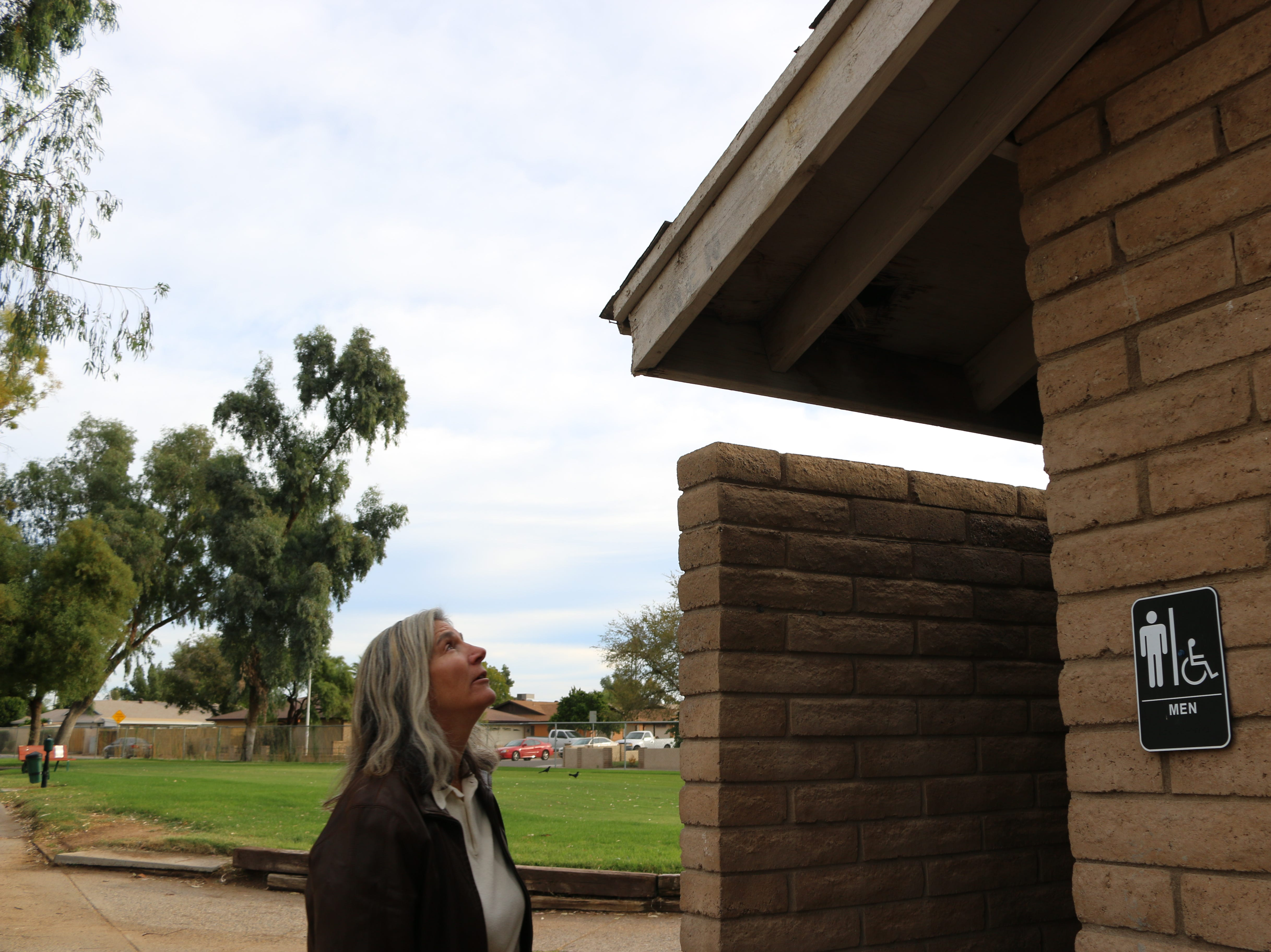 Michelle Woytenko, Glendale's field operations director, points out issues at the bathrooms at Glen Lakes Golf Course.