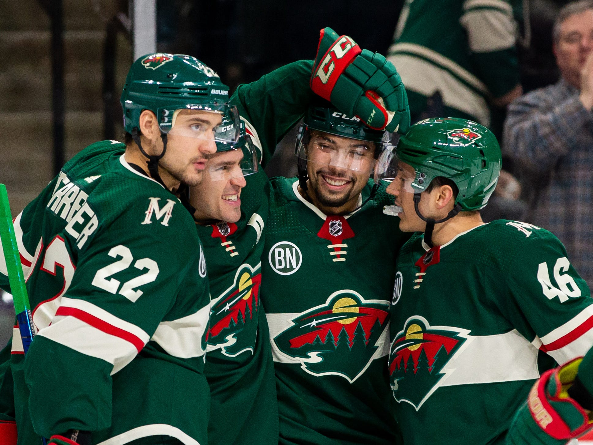 Nov 27, 2018; Saint Paul, MN, USA; Minnesota Wild forward Zach Parise (11) celebrates his goal with forward Nino Niederreiter (22), defenseman Matt Dumba (24), and defenseman Jared Spurgeon (46) in the second period against Phoenix Coyotes  at Xcel Energy Center. Mandatory Credit: Brad Rempel-USA TODAY Sports