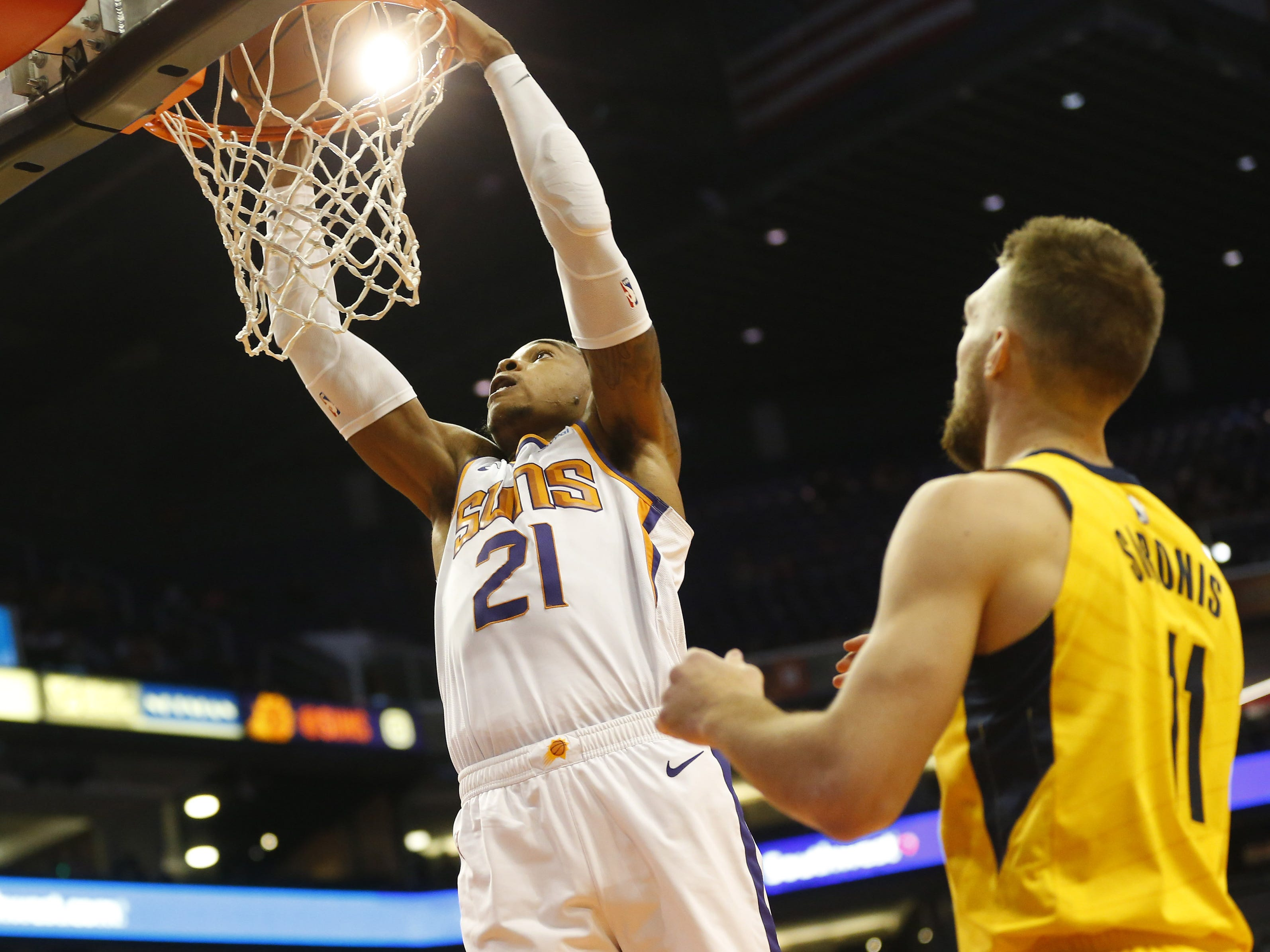 Phoenix Suns forward Richaun Holmes (21) slams two against Indiana Pacers forward Domantas Sabonis (11) during the first quarter November 27.