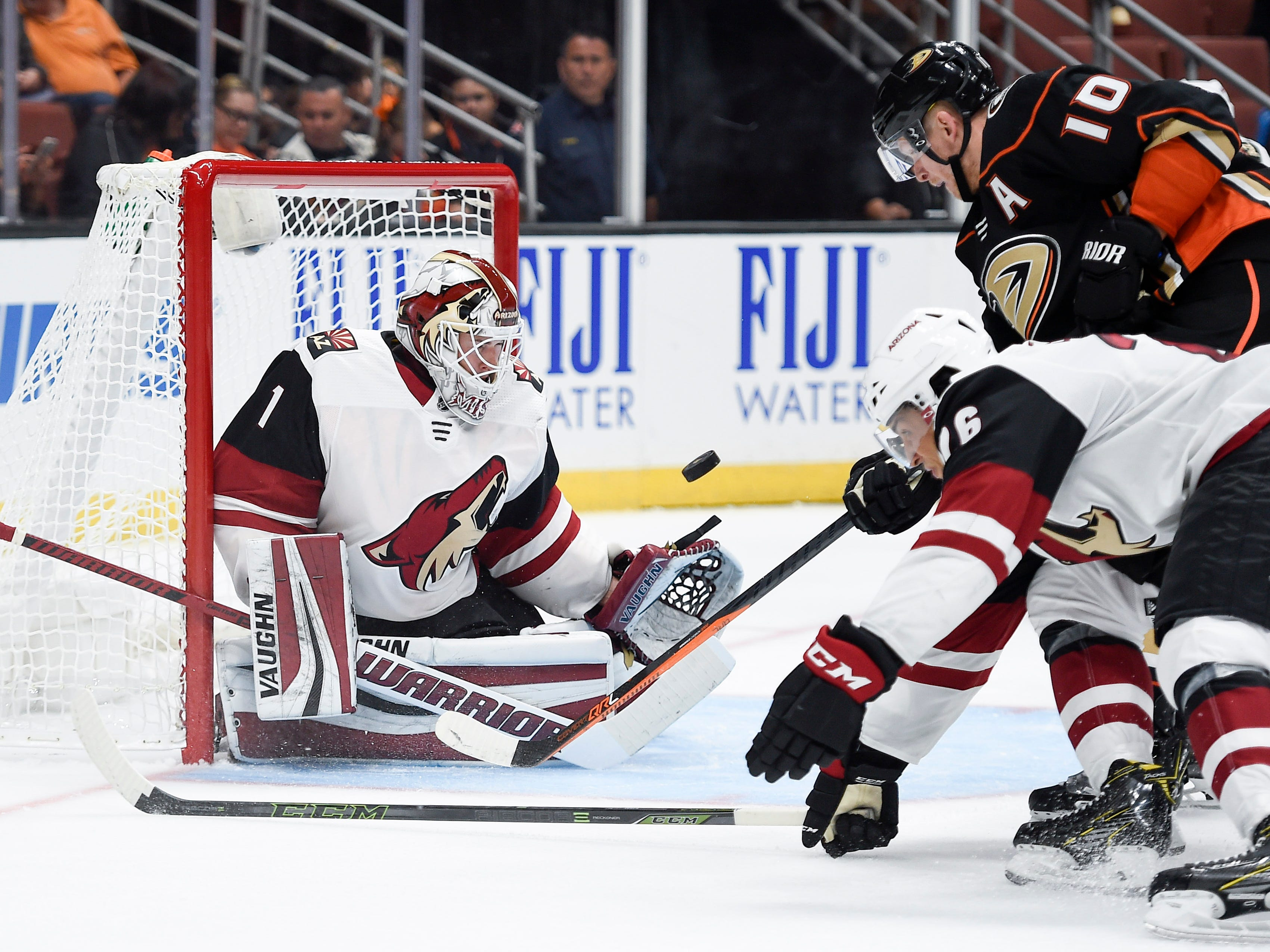 Sep 20, 2017; Anaheim, CA, USA; Phoenix Coyotes goalie Hunter Miska (1) makes a save in front of Anaheim Ducks right wing Corey Perry (10) during the third period at Honda Center. Mandatory Credit: Kelvin Kuo-USA TODAY Sports