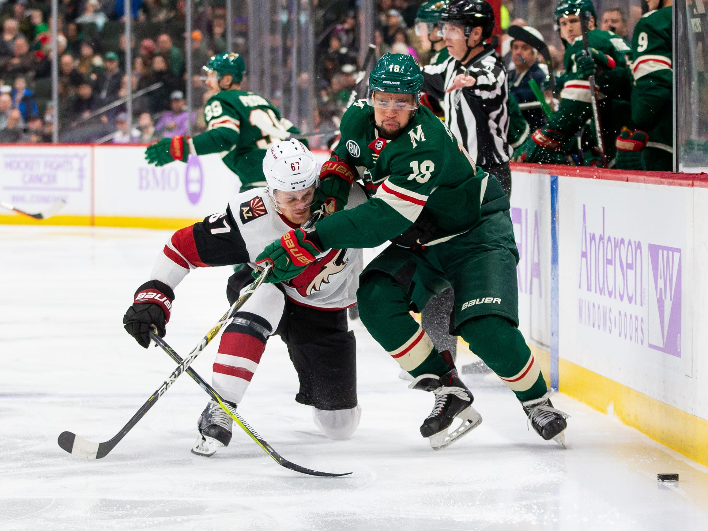 Nov 27, 2018; Saint Paul, MN, USA; Phoenix Coyotes forward Lawson Crouse (67) and Minnesota Wild forward Jordan Greenway (18) skate after the puck in the second period at Xcel Energy Center. Mandatory Credit: Brad Rempel-USA TODAY Sports