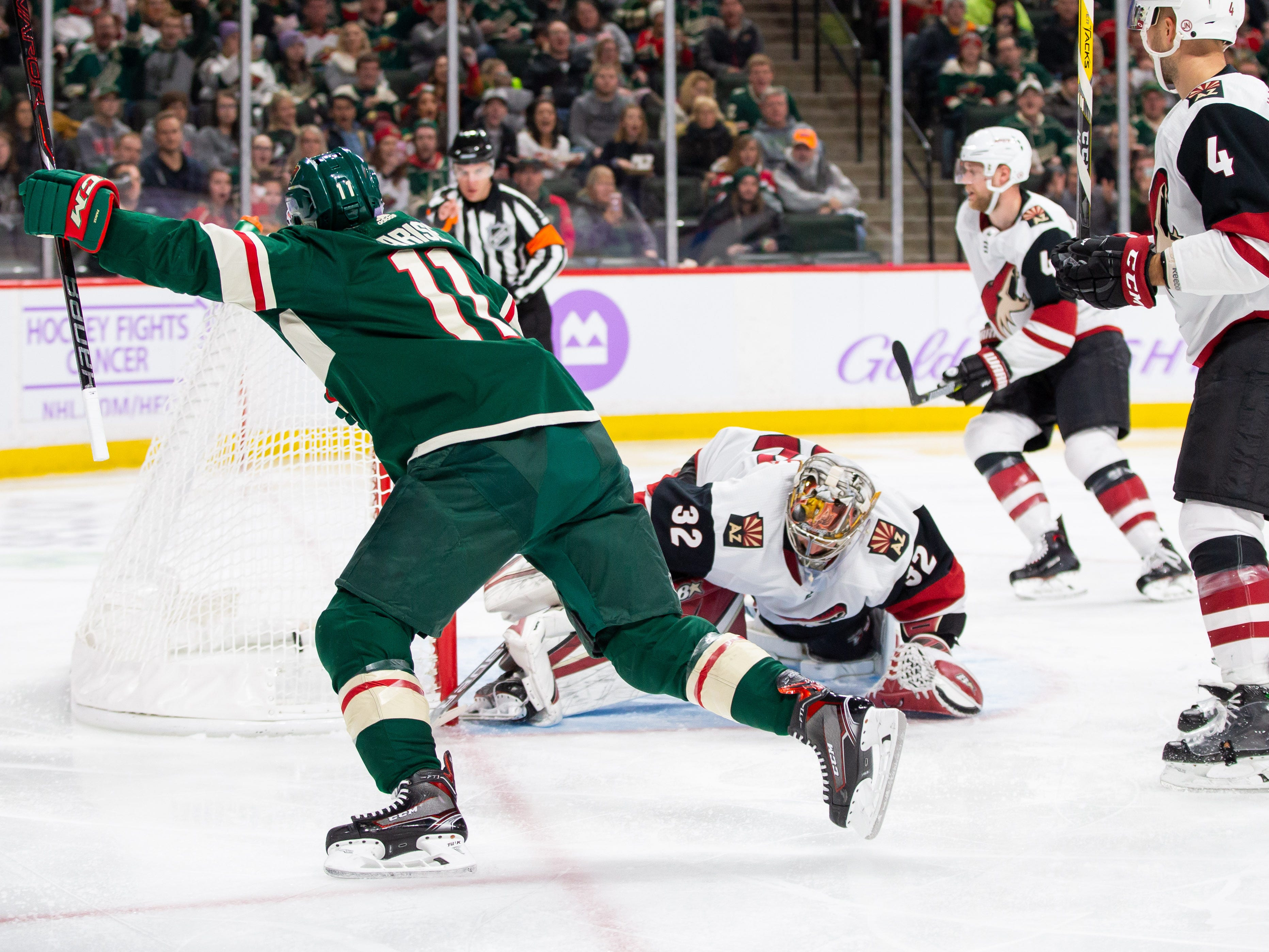 Nov 27, 2018; Saint Paul, MN, USA; Minnesota Wild forward Zach Parise (11) scores in the second period against Phoenix Coyotes goalie Antti Raanta (32) at Xcel Energy Center. Mandatory Credit: Brad Rempel-USA TODAY Sports
