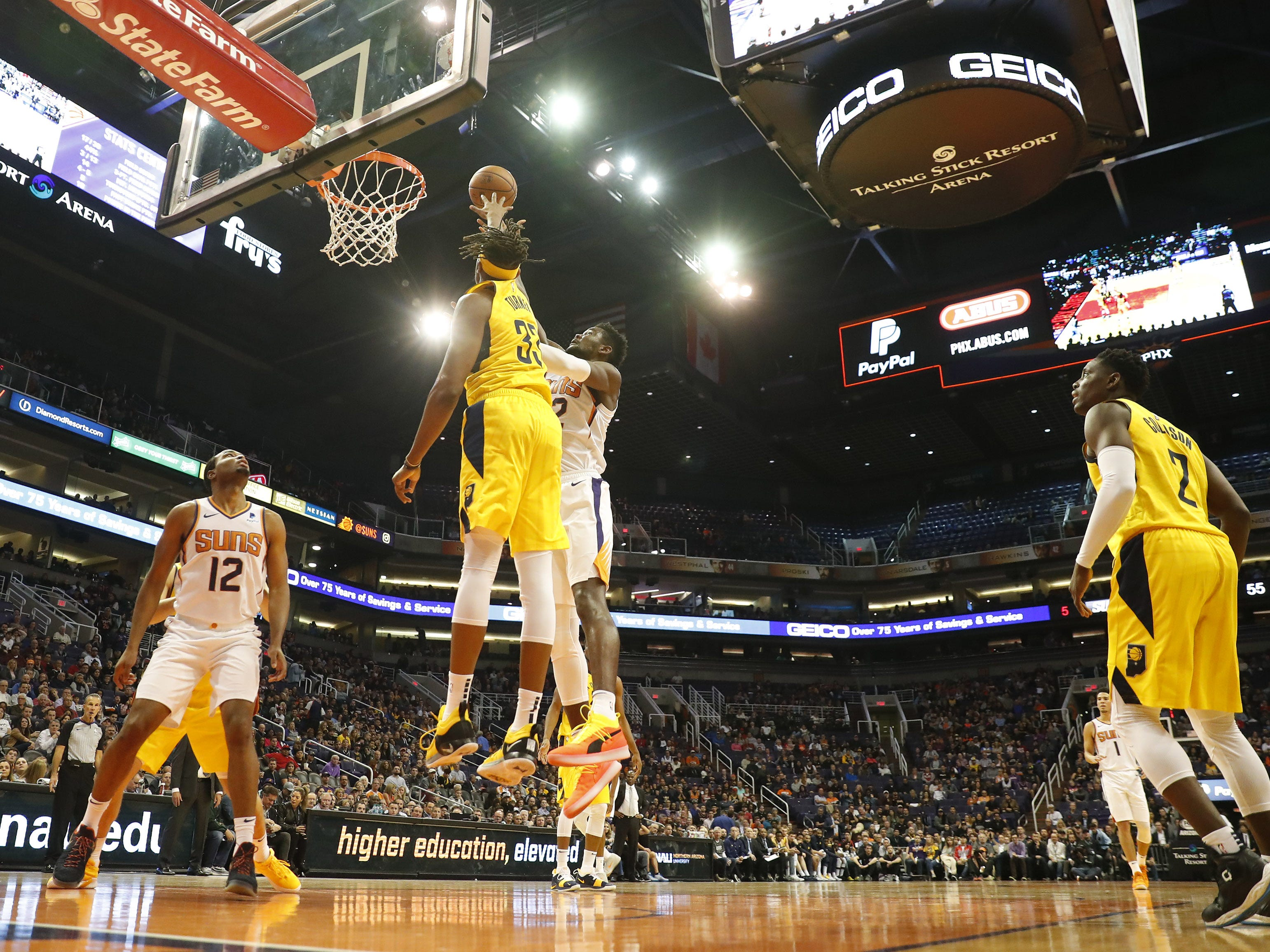 Phoenix Suns center Deandre Ayton (22) shoots over Indiana Pacers center Myles Turner (33) during the second quarter November 27.