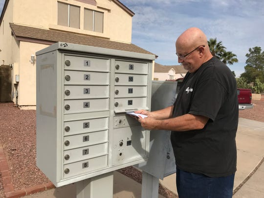 Dennis O'Melia takes a moment to drop off letters for James Blackwell, a Marine veteran with mobility challenges.