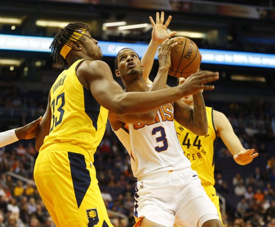 Phoenix Suns forward Trevor Ariza (3) puts a shot up between Indiana Pacers center Myles Turner (33) and forward Bojan Bogdanovic (44) during the first quarter November 27.
