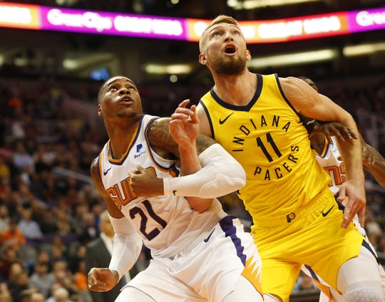 Phoenix Suns forward Richaun Holmes (21) boxes out Indiana Pacers forward Domantas Sabonis (11) during the fourth quarter November 27.