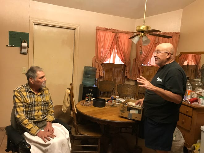 Dennis O'Melia, right, describes the meals he's brought for Glendale resident Anthony Longbein, who has an advanced form of cancer.