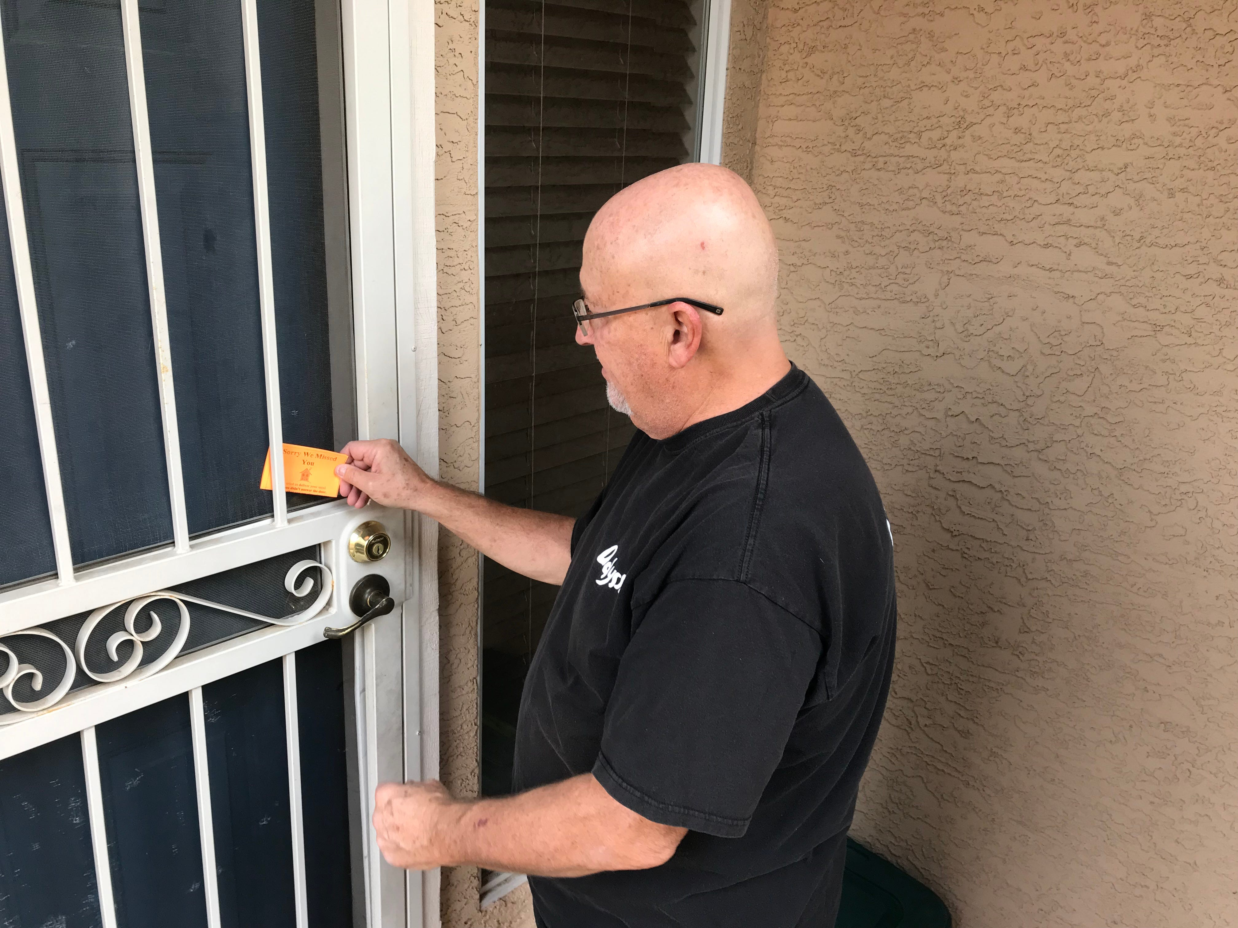 """Dennis O'Melia leaves an """"I'm sorry we missed you"""" slip. Clients typically inform Meals on Wheels if they won't be home, but that's not always possible in some cases."""