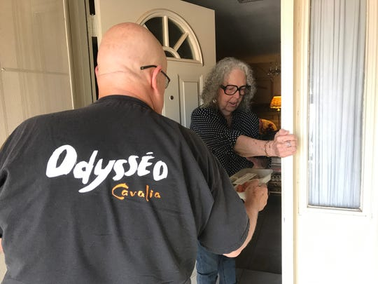 Marge Menefee, of Glendale, greets Meals on Wheels driver Dennis O'Melia.