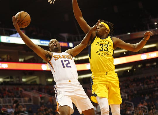 Phoenix Suns forward T.J. Warren (12) puts a shot up against Indiana Pacers center Myles Turner (33) during the first quarter November 27.