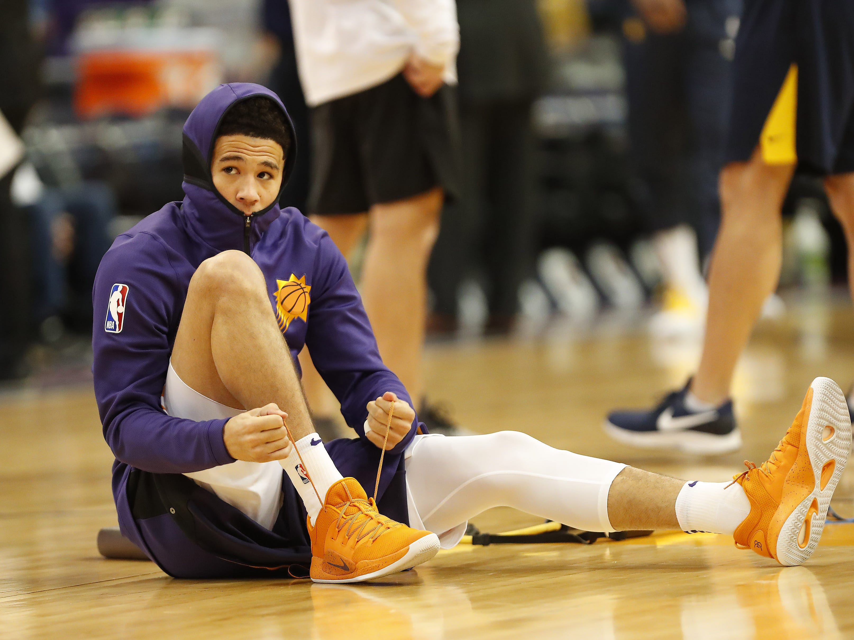 Phoenix Suns guard Devin Booker (1) laces up his shoes before playing against the Indiana Pacers November 27.