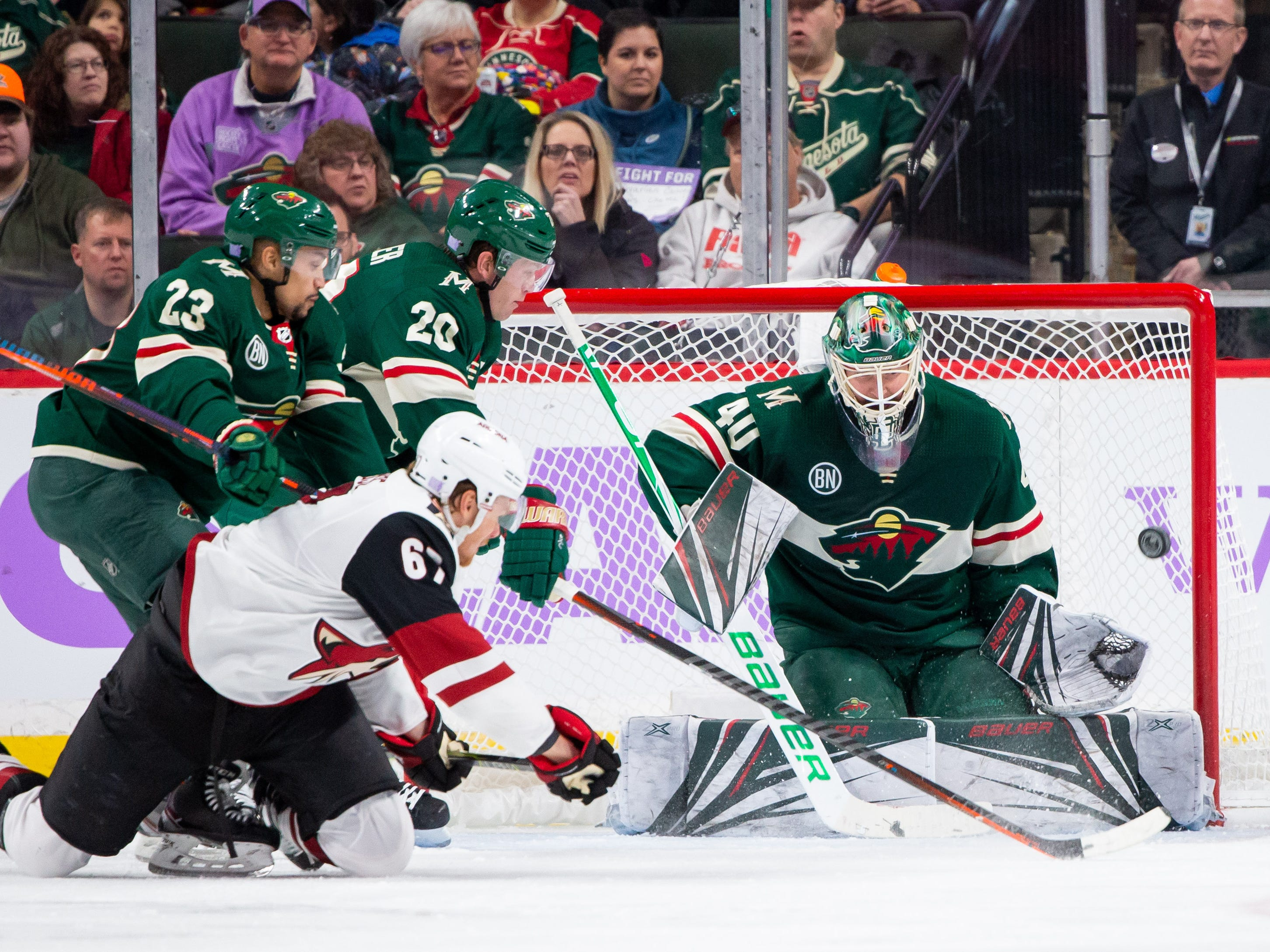 Nov 27, 2018; Saint Paul, MN, USA; Phoenix Coyotes forward Lawson Crouse (67) shoots in the second period against Minnesota Wild goalie Devan Dubnyk (40) at Xcel Energy Center. Mandatory Credit: Brad Rempel-USA TODAY Sports