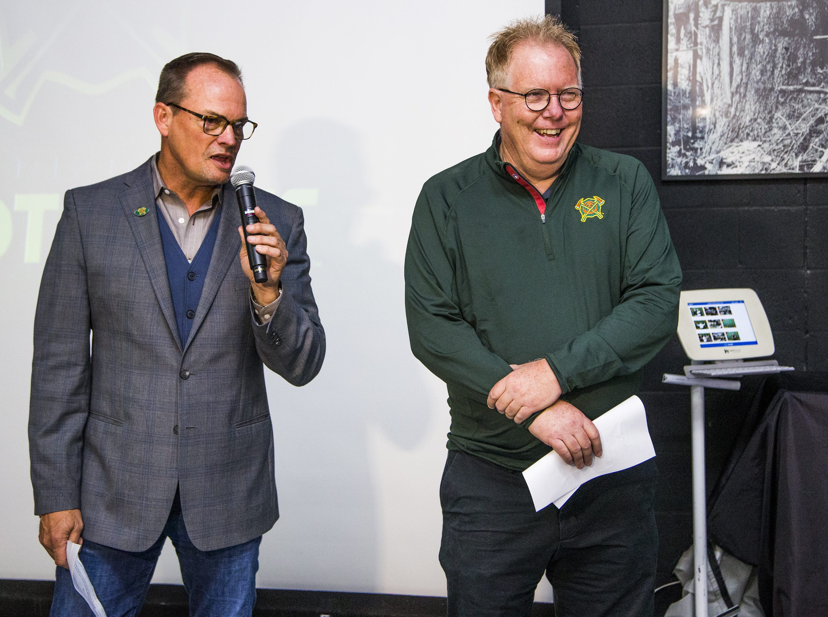 Arizona Hotshots president Scott Brubaker, left, introduces Jeff Munn as the voice of the new professional football team at an event at Lumberjaxes in Tempe, Tuesday, November 27, 2018.