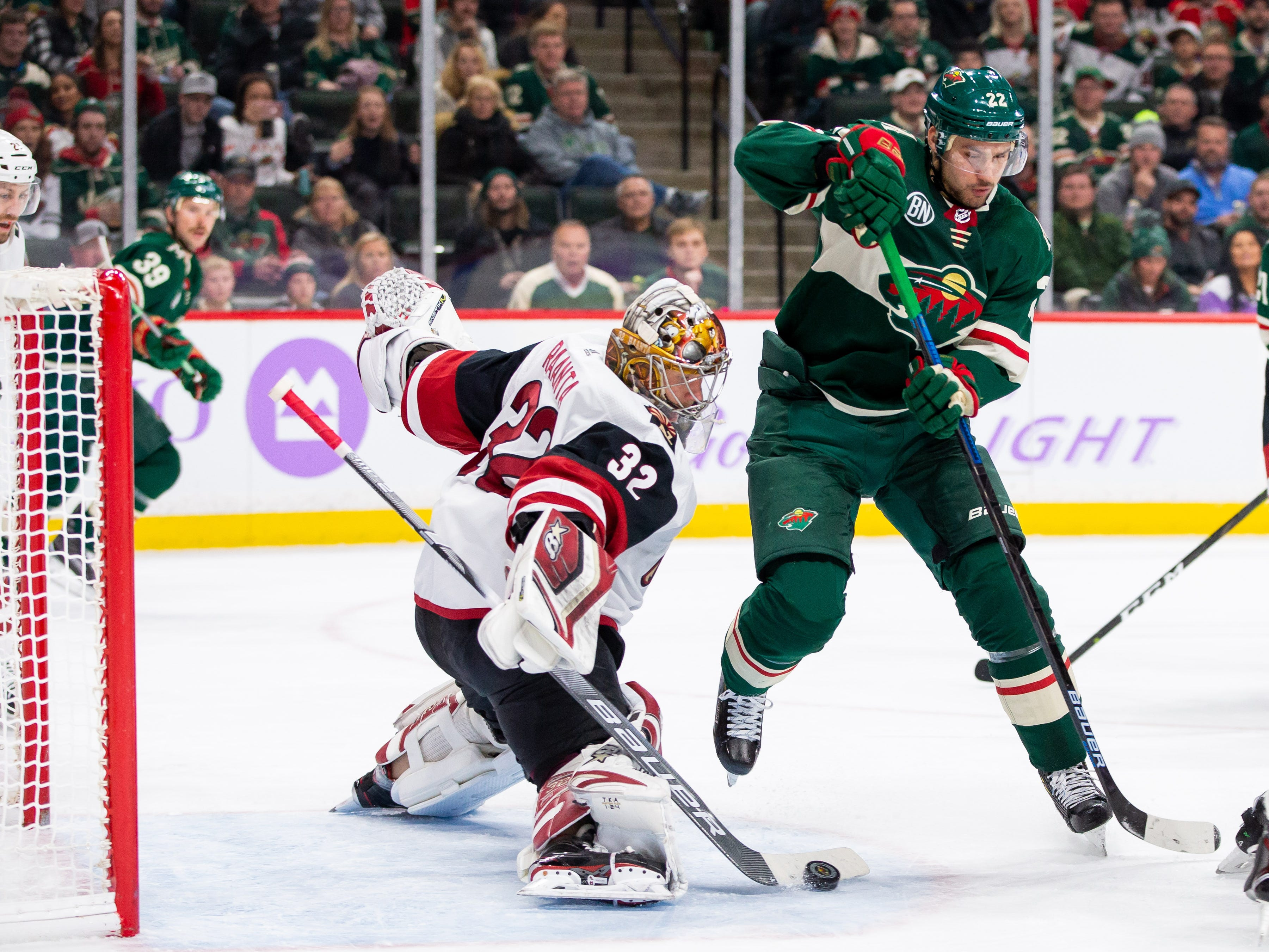 Nov 27, 2018; Saint Paul, MN, USA; Phoenix Coyotes goalie Antti Raanta (32) makes a save in the second period against Minnesota Wild forward Nino Niederreiter (22) at Xcel Energy Center. Mandatory Credit: Brad Rempel-USA TODAY Sports