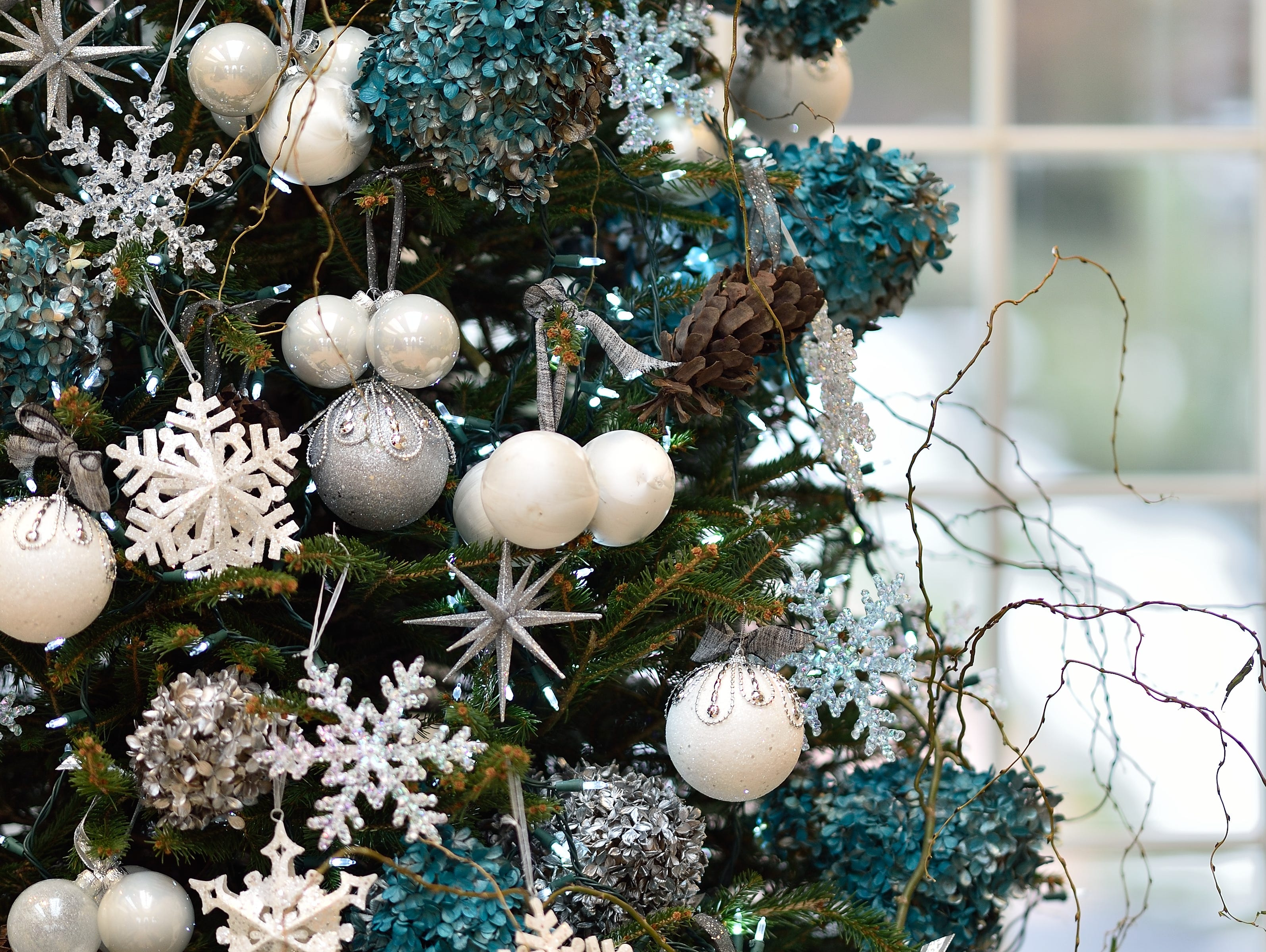 Designers for the Christmas Trees are these floral designers:   •         Floral Designs of Mt. Joy,  •         Jeffrey's Flowers (Mechanicsburg),  •         Maria's Flowers (Hershey),  •         Paper Moon Flowers & Events (Harrisburg),  •         Rhapsody in Bloom (Palmyra) and  •         Royer's Flowers & Gifts (Hershey).