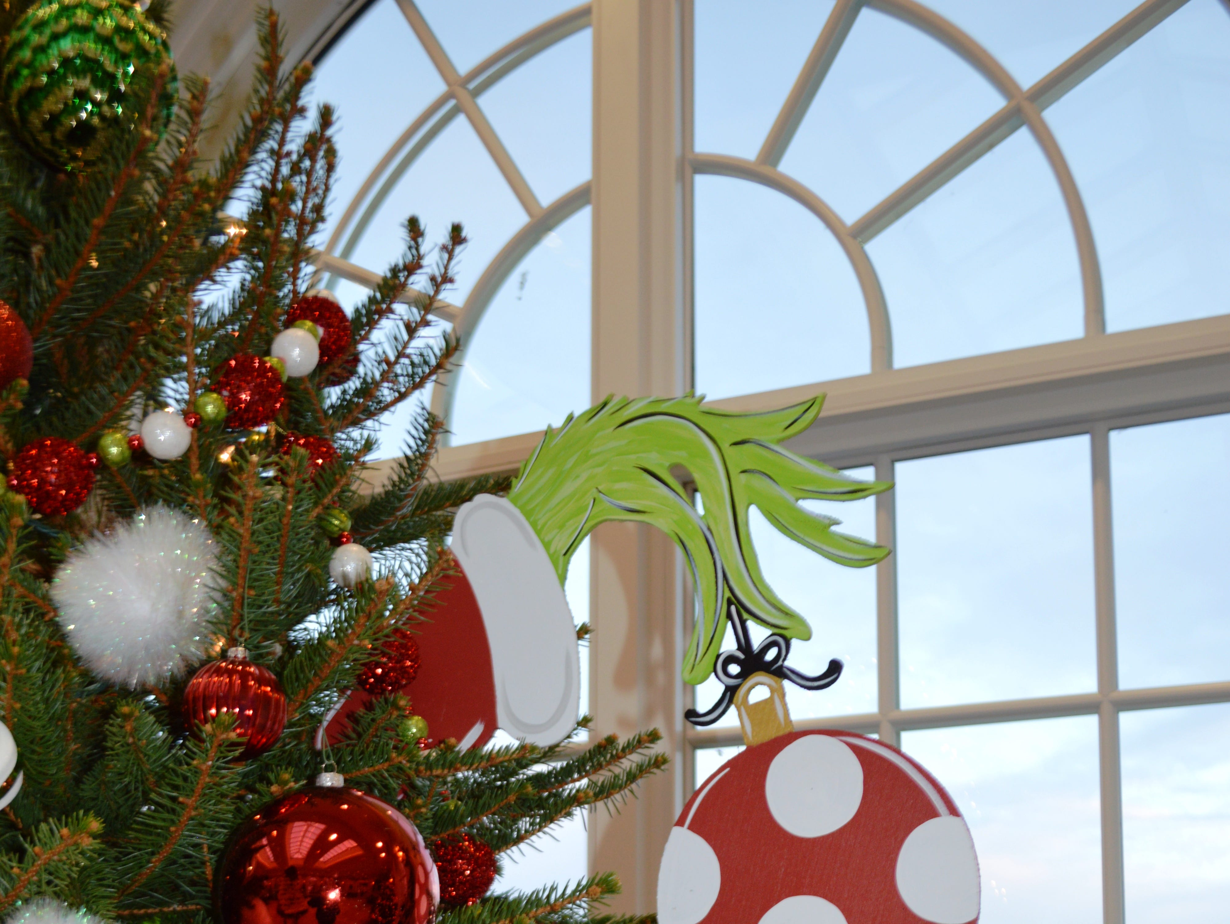 Rhapsody in Bloom from Palmyra is one of the floral designers featured at The Christmas Tree Showcase. Their tree is based on The Grinch Who Stole Christmas.