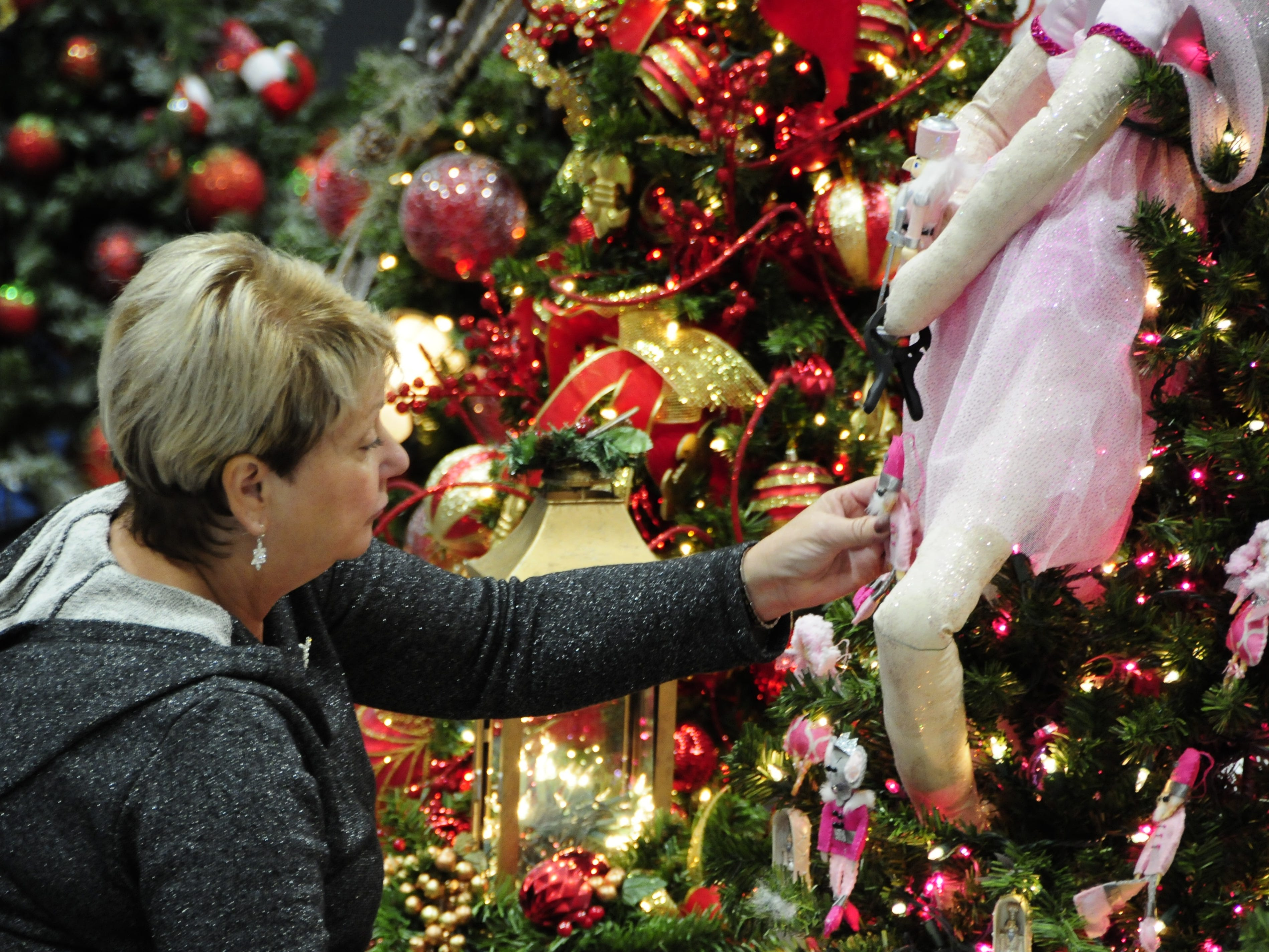 "Patricia Toth creates a ""Nutcracker in Pink"" tree Wednesday for the Festival of Trees, Friday through Sunday at the Blue Water Convention Center."