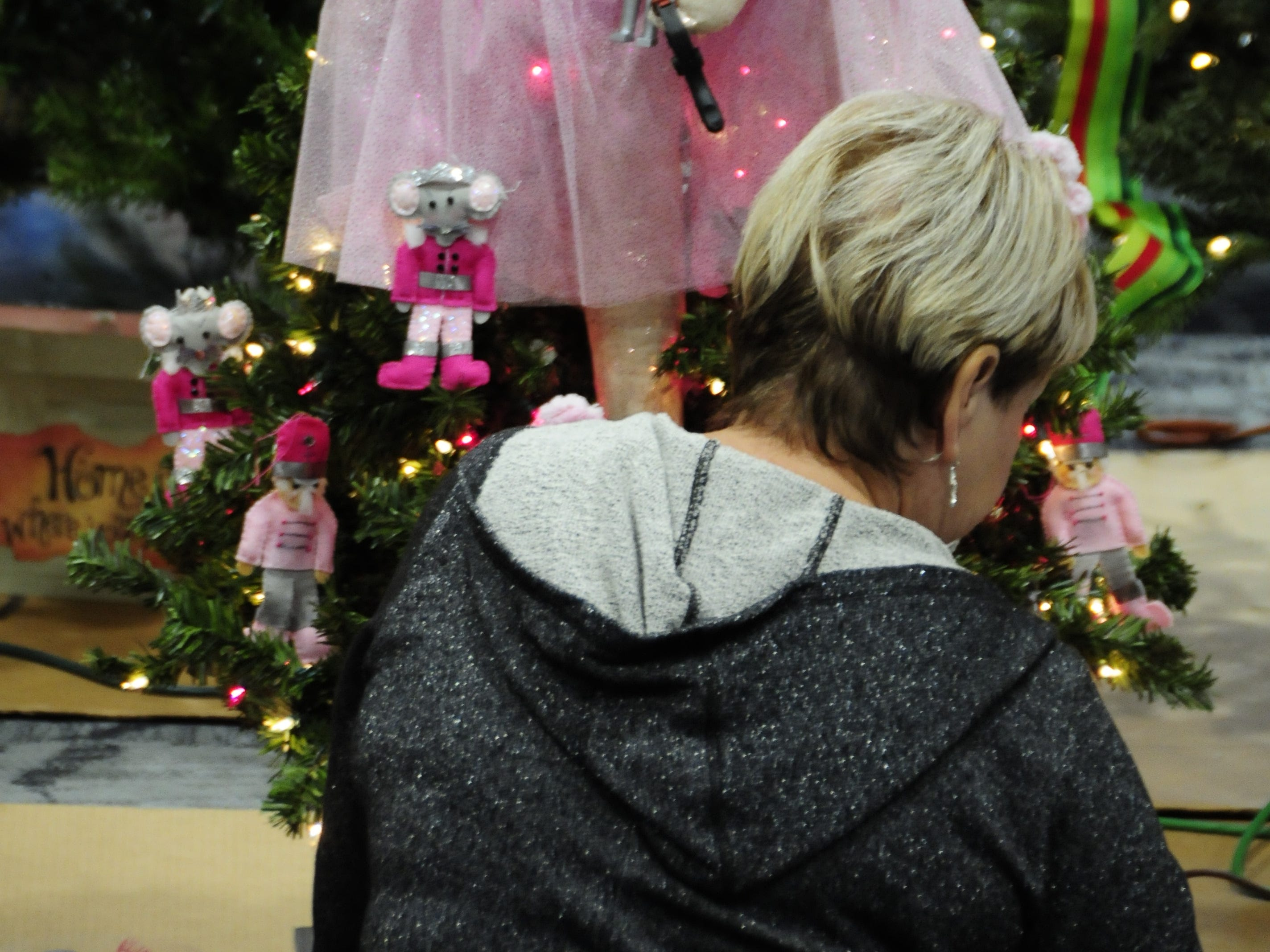 "Patricia Toth works on a ""Nutcracker in Pink"" tree Wednesday for the Festival of Trees, Friday through Sunday at the Blue Water Convention Center."