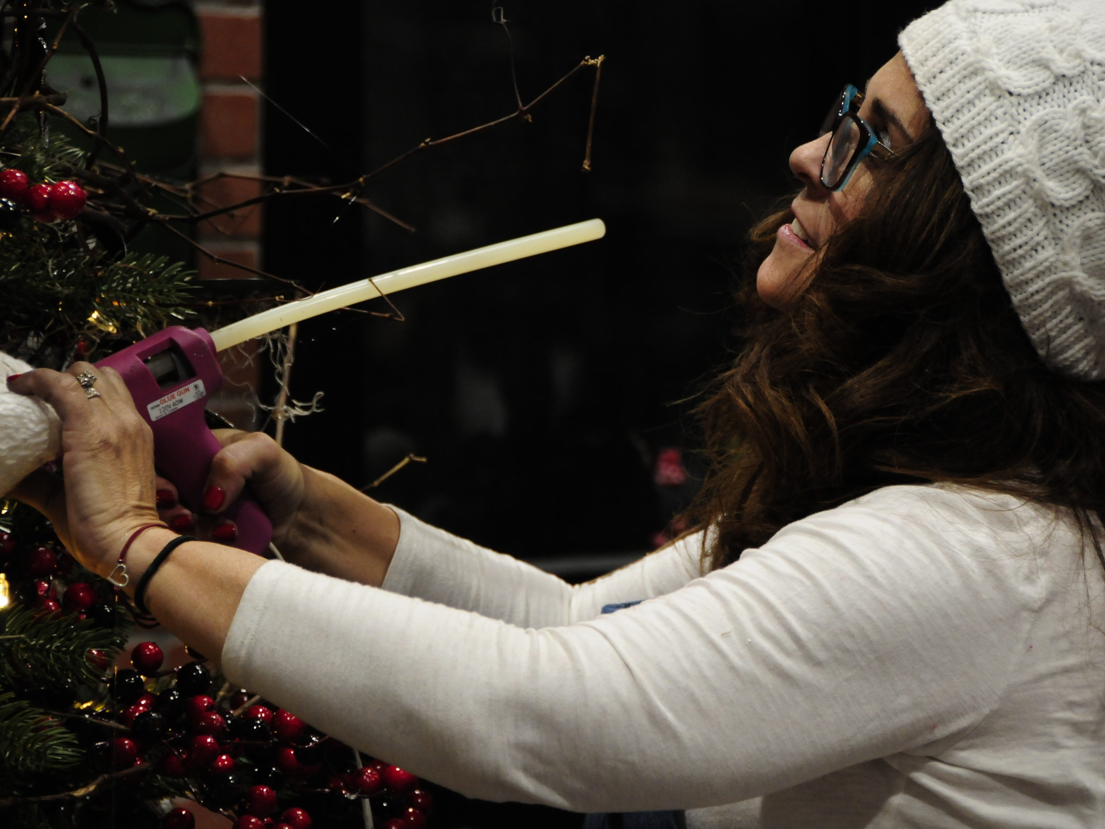 Carol Nemecek decorates a tree Wednesday for the Festival of Trees, Friday through Sunday at the Blue Water Convention Center.